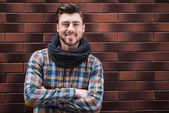 Handsome young man leaning wall — Stock Photo