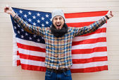 Young man holding American flag — Stock Photo