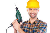 Confident young male carpenter in hardhat — Stock Photo