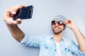 Handsome young man making selfie — Stock Photo