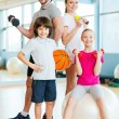 Family holding different sports equipment — Stock Photo #68200913
