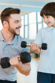 Father and son in health club — Stock Photo