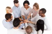Group of people keeping hands clasped — Stock Photo