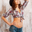 Beautiful young woman in cowboy hat — Stock Photo #71395399