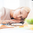 Woman sleeping at working place in office — Stock Photo #71617579