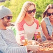 People eating pizza and drinking beer — Stockfoto #71832267