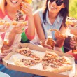 People eating pizza and drinking beer — Stockfoto #71832415