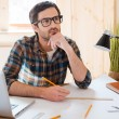 Thoughtful man sitting at working place — Stock Photo #72057989