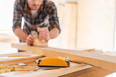 Carpenter working with wood in workshop — Stock Photo