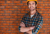 Smiling young man in hardhat — Stock Photo