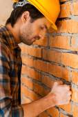Depressed young building contractor in hardhat — Stock Photo