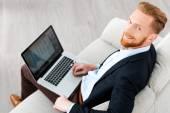 Bearded businessman working on laptop — Stock Photo