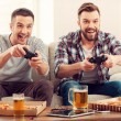Happy men playing video games — Stock Photo #73022285