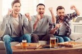Men watching football game — Stock Photo