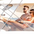 Couple sitting on board of yacht — Stockfoto #74088845