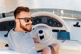 Young man driving yacht — Stock Photo