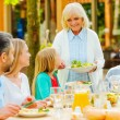 Family enjoying meal together  outdoors — Stock Photo #74729067