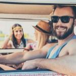 Man sitting on front seat of minivan — Stock Photo #75405605