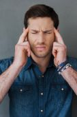 Frustrated man touching his head — Stock Photo