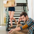 Frustrated young man sitting on  floor — Stock Photo #76029225