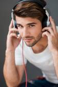 Man in headphones listening to music — Stock Photo