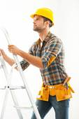 Crafts person climbing up ladder — Stock Photo