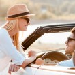 Man in convertible while his girlfriend leaning at  door — Stock Photo #77936554