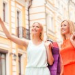 Woman and mother carrying shopping bags — Stock Photo #78517280
