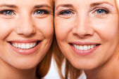 Smiling mother and her daughter — Stock Photo