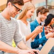People holding different digital devices — Stock Photo #78995738