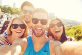 Young people making selfie on roof — Stock Photo
