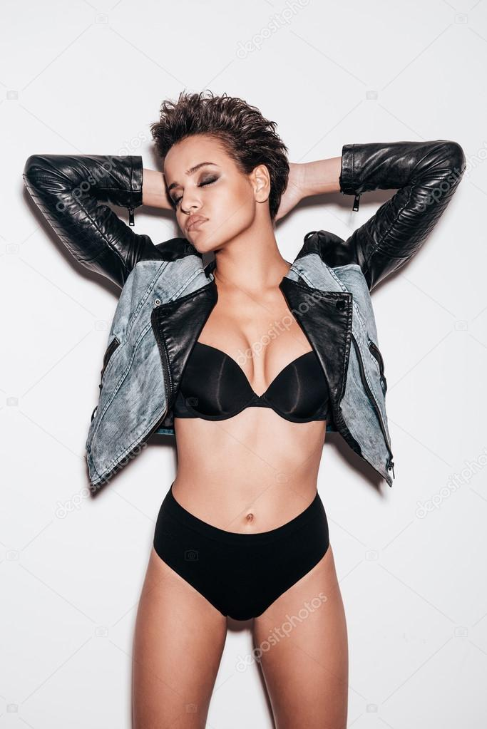 Woman in black underwear and leather jacket — Stock Photo