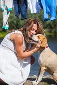 Pregnant woman caressing dog — Stock Photo