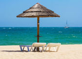 Sun chairs and parasol — Stock Photo