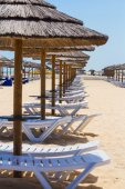 Sun chairs and parasols — Stock Photo