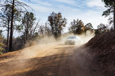 Dusty mountain road — Stock Photo
