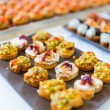 Plate with canapes — Stock Photo #58523855