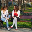 Best friends talking in the park — Stock Photo #60911721