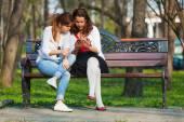 Women focused on mobile phone — Stock Photo
