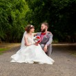 Bride and Groom Sitting Portrait Outdoors — Stock Photo #56509173