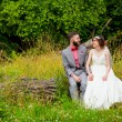 Bride and Groom Sitting Portrait Outdoors — Stock Photo #56509263