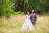 Bride and Groom in Field — Stock Photo