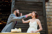 Bride and Groom with Wedding Cake — Stock Photo