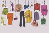 Womans clothing and accessories hanging on ropes — Stock Photo