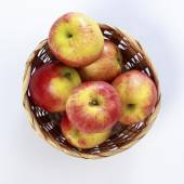 Jonagold apples in a basket on white background — Stock Photo