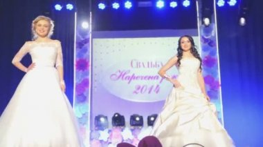 "VINNITSA, UKRAINE - DECEMBER 12: Competition ""Bride of the Year "". Showing wedding dresses on stage.Contestants ""Bride of the year 2014"". December 12, 2014 in Vinnitsa, Ukraine. — Stock Video"