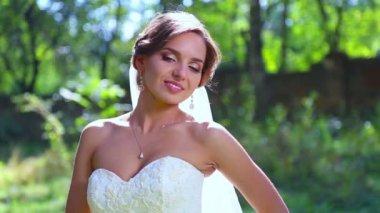 Caucasian bride in rose petals. Bride in wedding day in the petals of flowers. Bride on the background of falling rose petals.  Holiday, wedding, happiness. — Stock Video