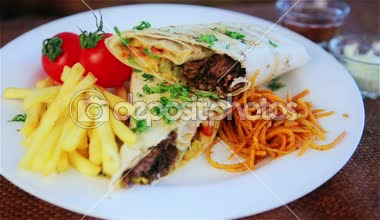 Traditional middle eastern food, shawarma with garnish. Picture of traditional Eastern warm sandwich with garnish. Oriental cuisine, shawarma, kebab. — Stock Video