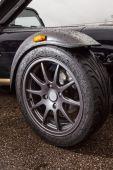 Sport car wheel on race track — Stock Photo