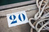 Marine white rope and number on the ground, marina — Stock Photo